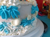 White chocolate seashells in the swirling frosting foam.